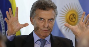 Argentina's President-elect Mauricio Macri attends a meeting with Brazilian and Argentine businessmen at the Sao Paulo's Industries Federation, in Sao Paulo, Brazil, Friday, Dec. 4, 2015. Macri is visiting Brazil on his first international trip after winning last month's vote. (AP Photo/Andre Penner)